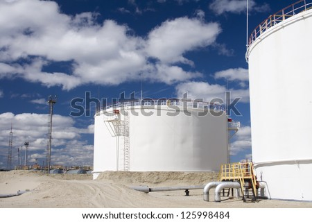 Oil industry and gas industry. Work of refinery petrochemical plant. Oil reservoir and storage tank of mineral oil - stock photo