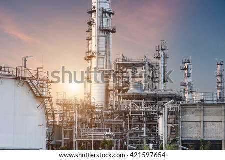 Oil Industry Refinery factory at Sunset, Petroleum, petrochemical plant - stock photo