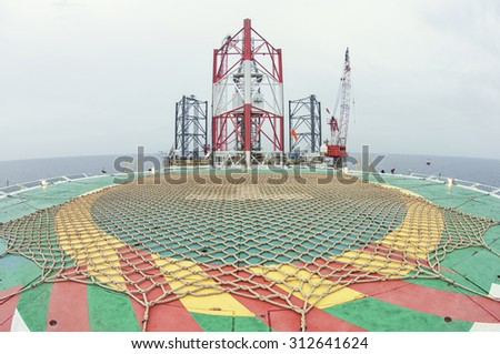 Oil industry Rig (Jack Up Drilling Rig) with helidec for helicopter - stock photo