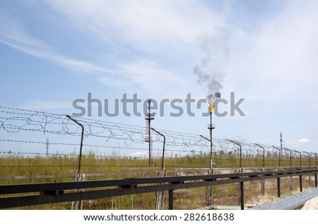 Oil industry. Work of refinery plant. Gas industry. Gas torch on petrochemical factory - stock photo