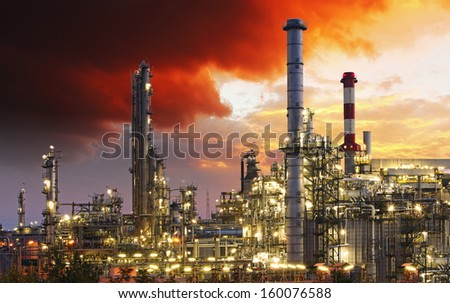 Oil indutry refinery - factory with dramatic sunset - stock photo