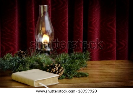 Oil lamp and Bible in church setting