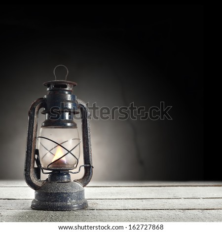 oil lamp and dark wall