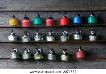 Oil lamps are placed on a timber wall ahead of Eid al-Fitr festival.
