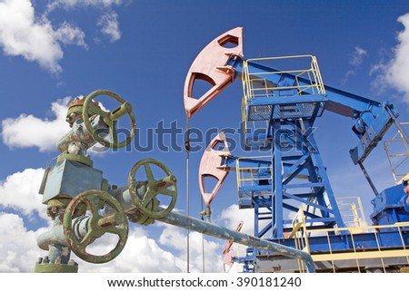 Oil latch and pumps - stock photo