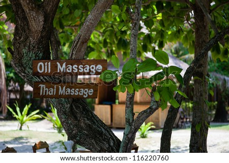 Oil massage table on a tree in Thailand - stock photo