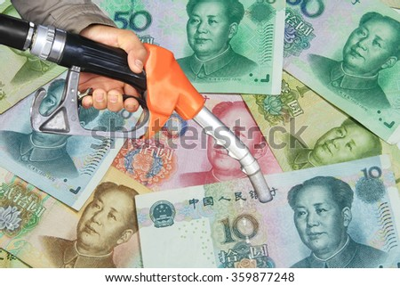oil nozzle and China Money banknote - stock photo
