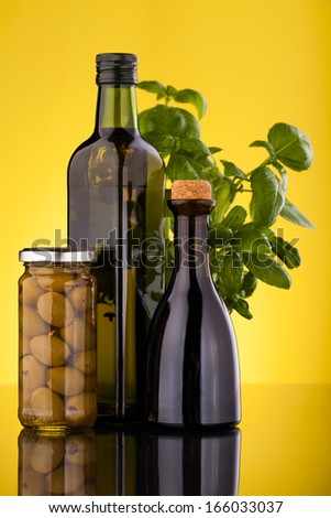 oil olive bottles  and basilic leaves
