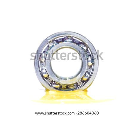 Oil on metal ball bearing  - stock photo