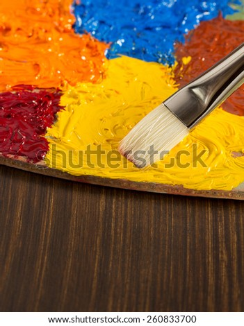 oil paint and brush on wooden background - stock photo