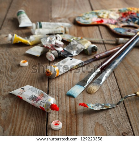 Oil paint and brushes - stock photo