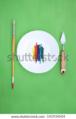 oil paint served like a dish with painting instruments - stock photo