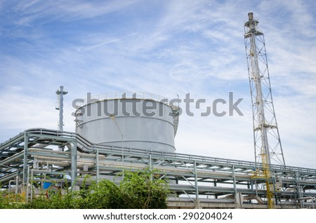 Oil pipeline and oil tank - stock photo