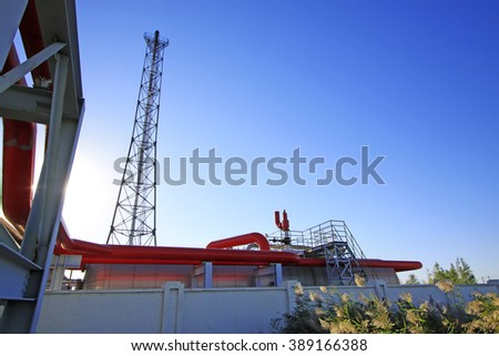 Oil pipeline and tower, closeup of photo