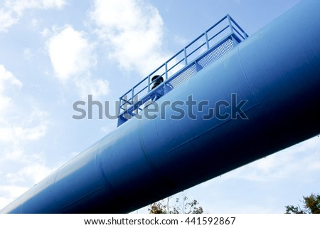 Oil pipeline,blue thick piping shine in blue sky