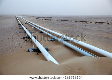 Oil pipeline in the desert of Qatar, Middle East - stock photo