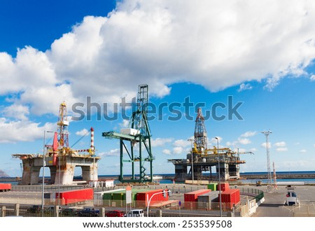 oil platforms with crane at port at sunny day - stock photo