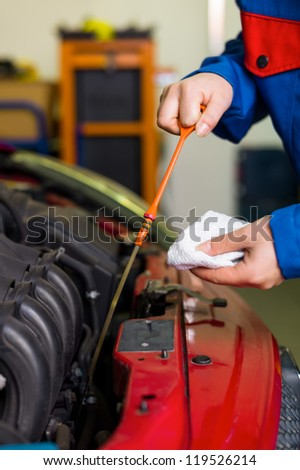 oil pressure is measured in the car. with the dipstick is the correct oil level checked - stock photo