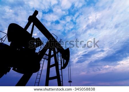 oil pump against blue sky - stock photo