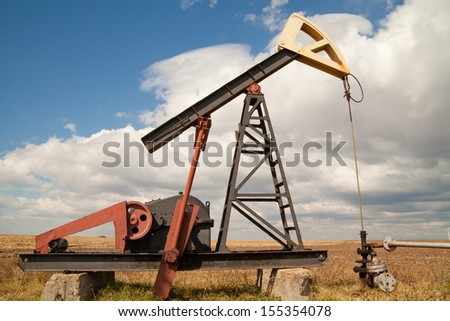 oil pump, cloudy sky