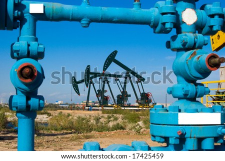 oil pump in autumn field - stock photo
