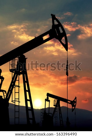 oil pump jack against sunset - stock photo