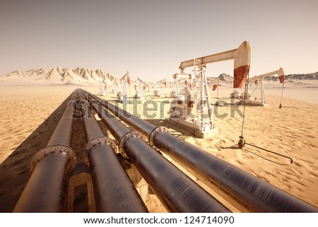 Oil pump jack rocking with pipeline in the background. - stock photo