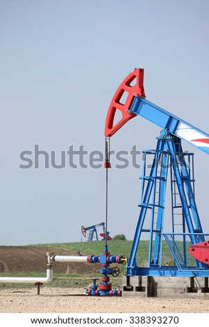 oil pump jacks on oilfield - stock photo
