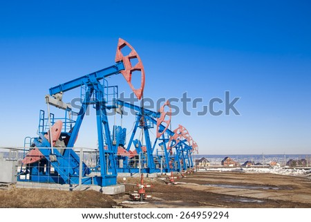Oil pump on background of blue sky - stock photo