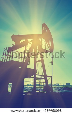 Oil pump on background of blue sky - instagram style