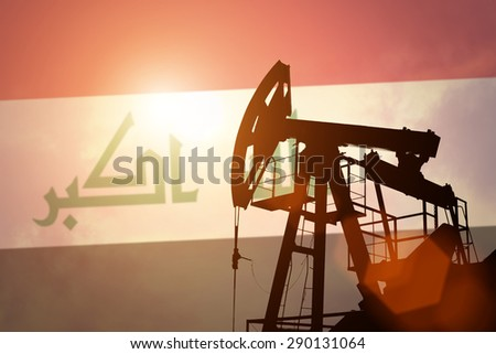 Oil pump on background of flag of Iraq - stock photo