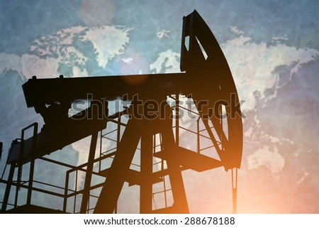 Oil pump on background of world map