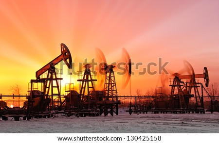 oil pumps at sunset sky background - stock photo