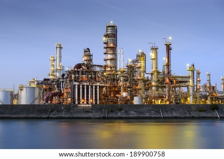 Oil refineries line a river in Yokkaichi, Japan. The city has been a center for the chemical industry since the 1930's. - stock photo