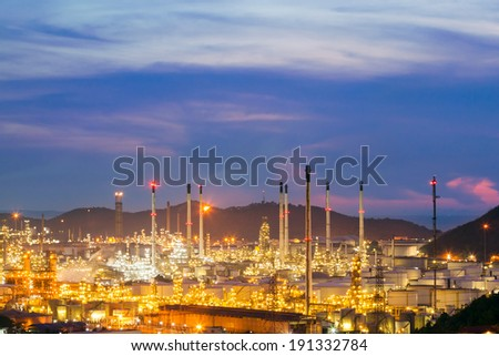 oil refinery against beautiful sunset - stock photo
