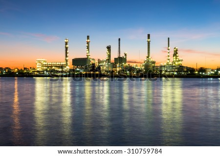 Oil refinery along Chao Phraya river at dusk Bangkok, Thailand - stock photo