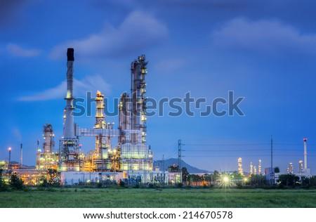 Oil refinery along twilight sky - stock photo