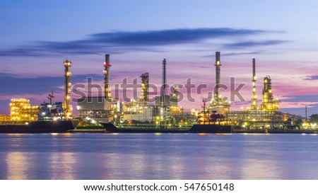 Oil refinery among grass at the early morning