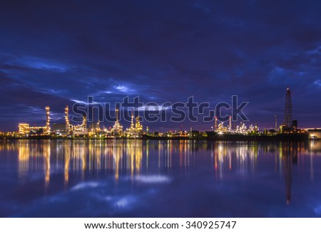 Oil refinery and Ship fuel delivery at twilight in bangkok, Chao Phraya river, city landscape bangkok Thailand