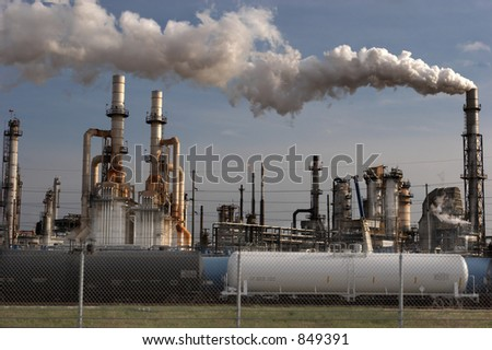 Oil refinery and train tank cars - stock photo