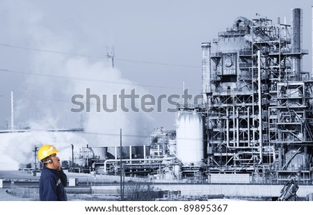 oil refinery and worker - stock photo