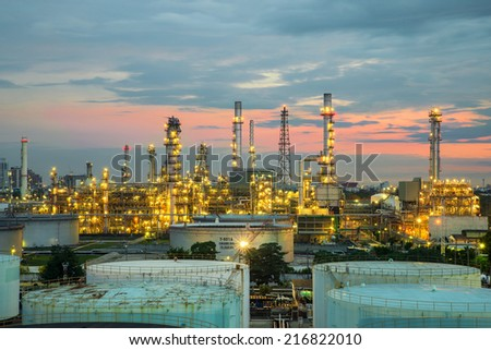 Oil refinery at dramatic twilight in Thailand - stock photo
