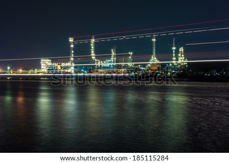 Oil refinery at night ,Bangkok Thailand with light from the boat - stock photo
