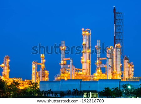 Oil refinery at night sky - stock photo
