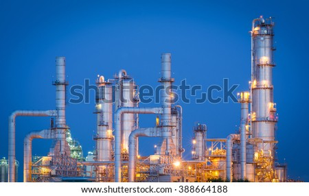 Oil refinery at night time - stock photo