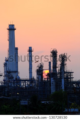 Oil refinery at sunrise vertical view