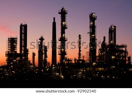 Oil refinery at sunset in Schleswig-Holstein, Germany. - stock photo