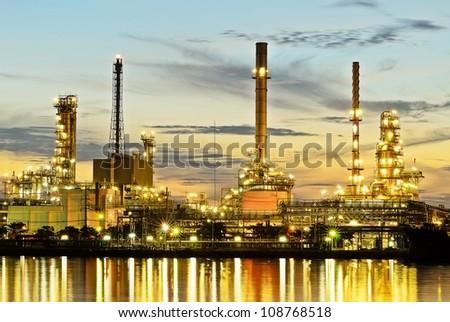 Oil refinery at twilight - stock photo