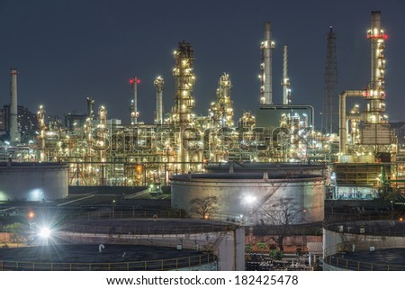 Oil refinery at twilight - stock photo