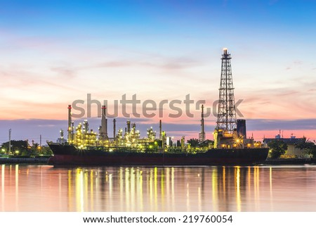 Oil refinery at twilight,Chao Phraya river, Thailand - stock photo
